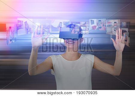 Happy woman gesturing while using virtual reality headset against table and empty chairs in office