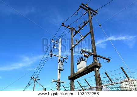 Black old electricity post strong and high