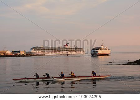 Victoria BC,Canada,August 11th 2014 .Kayakers,Coho ferry and a cruise ship on the waterway in Victoria BC.