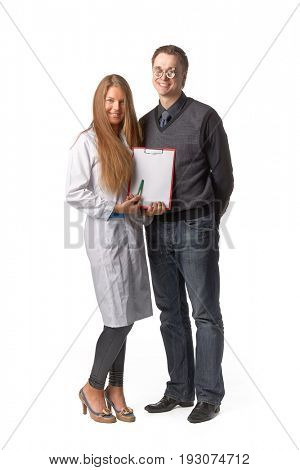 The beautiful  female oculist  with blank clipboard and  patient on a white background.