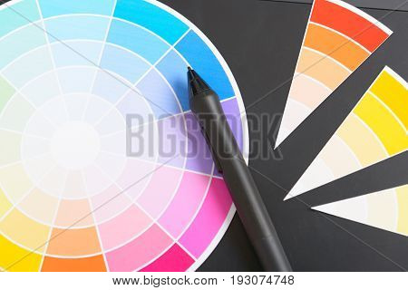 Color wheel and swatches of colour with stylus on a graphic tablet