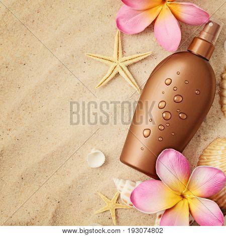 suntan lotion on sand beach