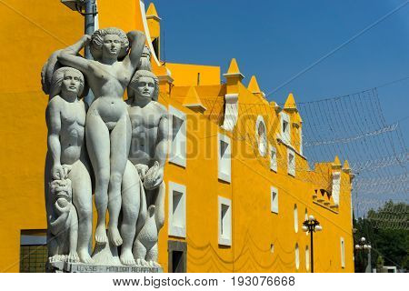 PUEBLA MEXICO - MARCH 2: Statues next to a historic yellow church in Puebla Mexico on March 2 2017