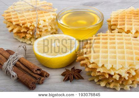 Waffle With Badian, Cinnamon, Honey, Lemon On A Light Wooden Background