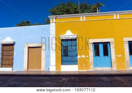 Yellow and blue colonial architecture in historic Campeche Mexico
