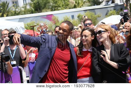 Will Smith, Jessica Chastain, Berenice Bejo attend the 70th Anniversary photocall during the 70th annual Cannes Film Festival at Palais des Festivals on May 23, 2017 in Cannes, France.