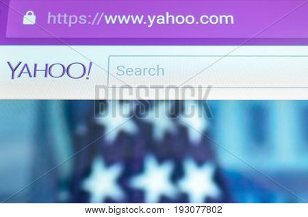 Brest, Belarus - June 28, 2017: Brand name yahoo mail on screen android phone. Search engine yahoo. The American flag is depicted in the background.