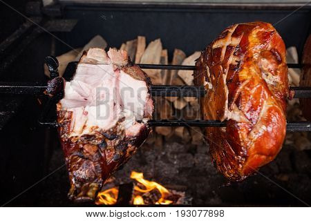 Knuckle of pork cooked on an open fire in the brazier