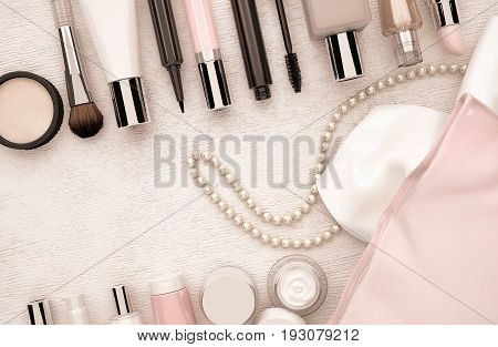 Make up products and string of pearls located on the light beige wooden background. 3D illustration