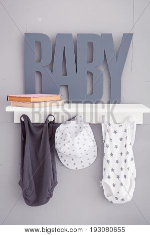 The word baby on a gray background. Inscription toddler. Detail of the interior of the children's room. Children bedroom.