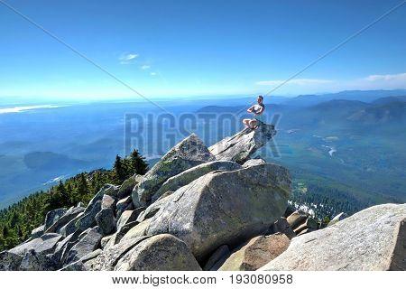 Meditation in mountains. Mount Pilchuck. Cascade Mountains.  Seattle. Washington. United States.