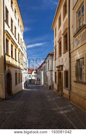 Empty street in Olomouc city in sunny day Czech Republic. Famous UNESCO heritage city and tourist attraction.