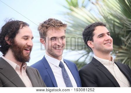 Ben Safdie,  Robert Pattinson,  Buddy Duress attends the 'Good Time' photocall during the 70th Cannes Film Festival at Palais des Festivals on May 25, 2017 in Cannes, France.