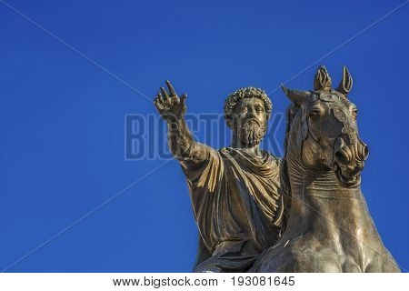 Ancient equestrian monument of emperor Marcus Aurelius a bronze replica of 2nd century AD statue in the center of Capitol Hill Square in Rome (with blue sky and copy space)
