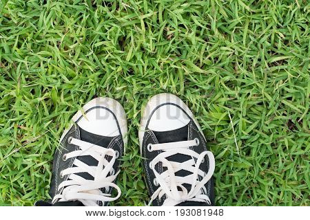 Black Sneakers On Green Grass