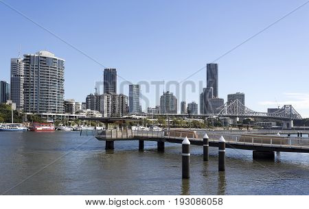 BRISBANE, AUSTRALIA - June 22, 2017: View of the Brisbane Riverwalk a water highway for pedestrians and cyclists over and along the Brisbane River between New Farm and the Brisbane CBD.