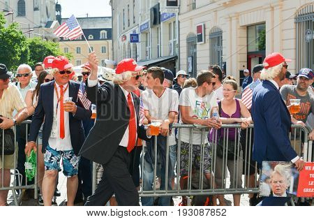 LE MANS, FRANCE - JUNE 16, 2017: Men in the parade of pilots in Le Mans with beer disguised as Donald Trump