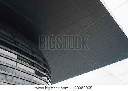 Copenhagen Denmark - August 12 2016: Low angle view detail of the Copenhagen Opera House against cloudy sky. It is the national opera house of Denmark and among the most modern opera houses in the world.