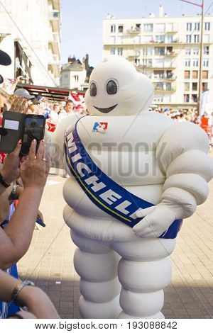 LE MANS, FRANCE - JUNE 16, 2017: White inflatable man - emblem of the company Michelin on a parade of pilots racing at Le mans, France