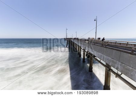 Los Angeles, California, USA - June 26, 2017:  Venice beach fishing pier with motion blur waves.