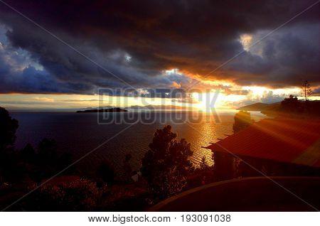 The Sun Setting Over The Isla De La Luna Seen From The Isla Del Sol On Lake Titicaca