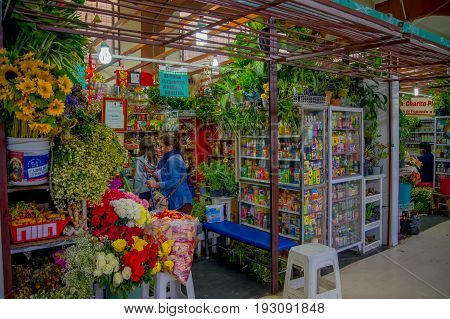 QUITO, ECUADOR - NOVEMBER 23, 2016: A flower market with some naturist medicine at the municipal market located in San Francisco in Quito city.