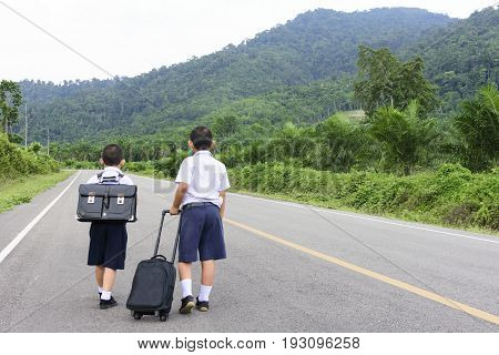 Asian  student,Behind of Asian student with bag are walking and nature view.