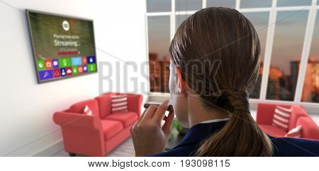 Rear view of businesswoman holding cigar against red sofas in living room at modern house