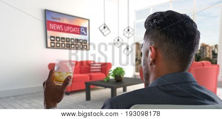 Rear view of businessman holding whisky glass against red sofas in modern living room