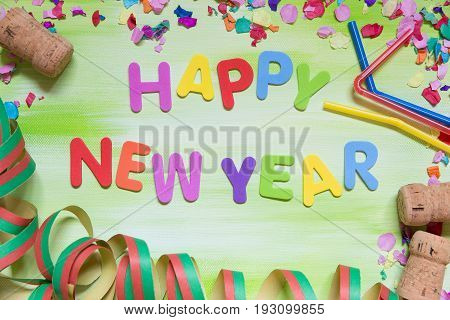 Colorful Letters With Corks, Confetti And Straws, Happy New Year