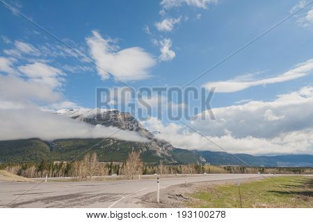 View of on ramp to Highway #1 with Grotto Mountain in the background Kananaskis Alberta Canada.