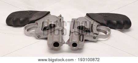Different caliber revolvers with a white back ground