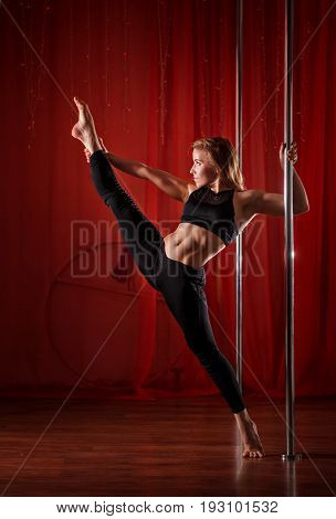 Sexy pole dancer sat on the twine. Flexibility and plasticity.