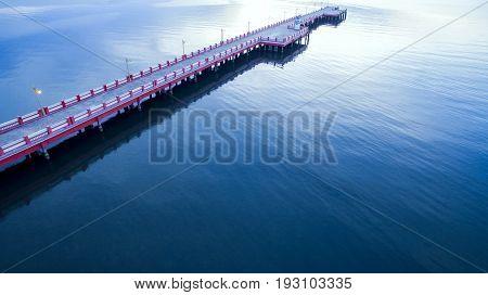 beautiful harbor bridge and blue plain sea in morning light