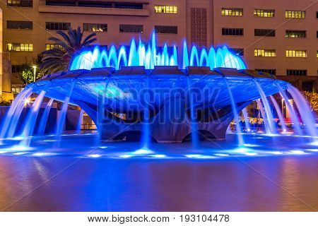 LOS ANGELES, CALIFORNIA - FEBRUARY 19, 2017:  The Arthur J. Will Memorial Fountain in Grand Park with blue LED lights showing in its synchronized water show.