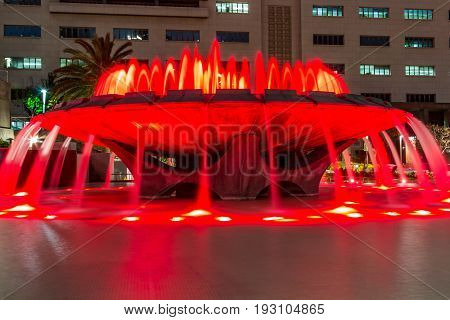 LOS ANGELES, CALIFORNIA - FEBRUARY 19, 2017:  The Arthur J. Will Memorial Fountain in Grand Park with red LED lights showing in its synchronized water show.