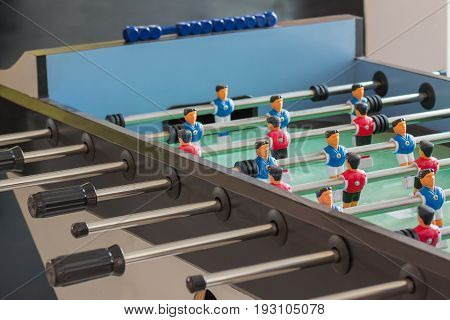 Toy goal football player table in home.