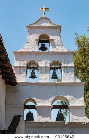 SAN DIEGO, CALIFORNIA - JUNE 24, 2017:  Bell tower of Mission Basilica San Diego de Alcala, the first Franciscan mission in The Californias, founded on July 16, 1769 by Spanish friar Junipero Serra.