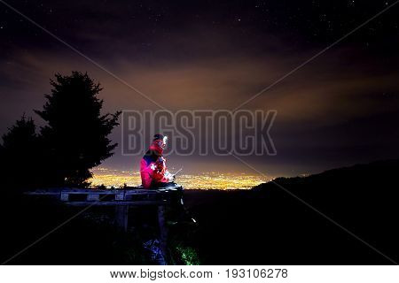 Lifeguard On Mountain Resort At Night