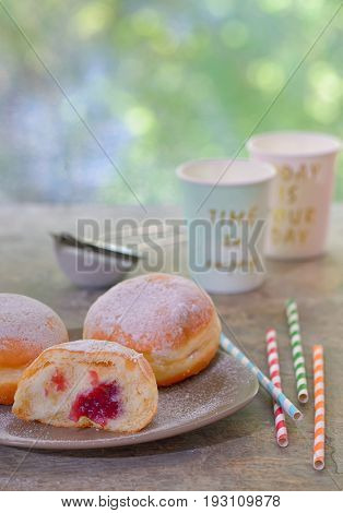 Fresh tasty donuts with jam