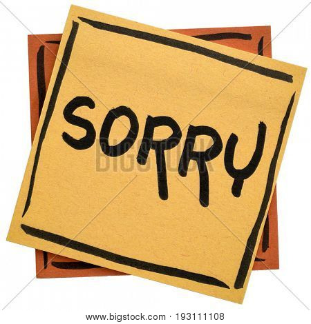 sorry apology - handwriting on an isolated sticky note
