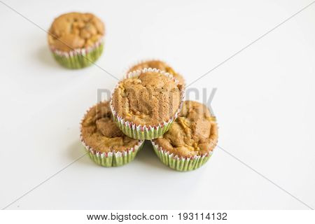 wholegrain muffins with apples on a dark wood background. tinting. selective focus