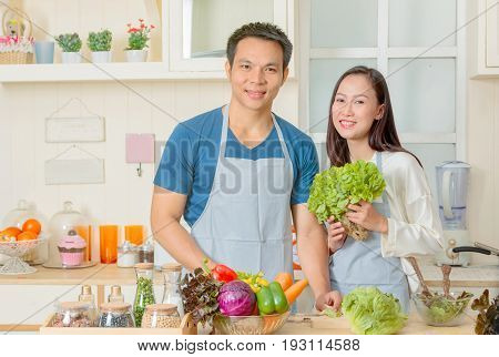 Happy Couple Cooking Together, Couple Preparing Salad With Fresh Ingredients