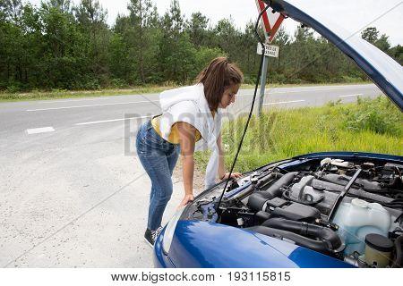 Portrait Stressed Girl Breakdown Car In Country