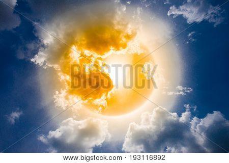 Sun halo circle rainbow blue sky cloud