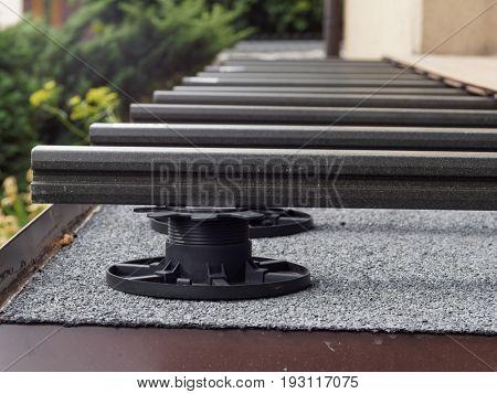 Rack, frame on terrace under decking boards