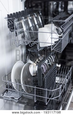 Close Up Of Utensils In Dishwasher After Cleaning Process