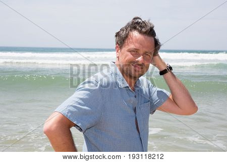 Handsome Mature Man In His Forties Wearing A Blue Shirt