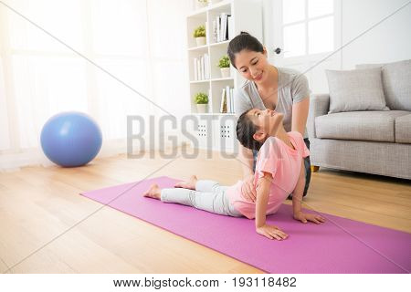 Mother Teaching Her Small Girl His Yoga Notions