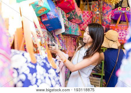 Asian Woman shopping in weekend market